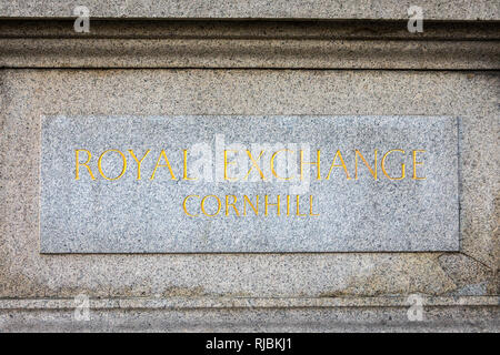 A plaque om the exterior of the Royal Exchange in the City of London, UK. - Stock Image