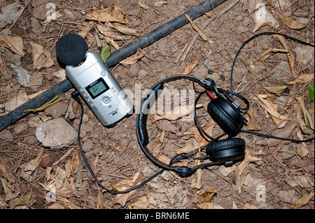 Zoom H4 digital audio recorder and headphones on location - Stock Image