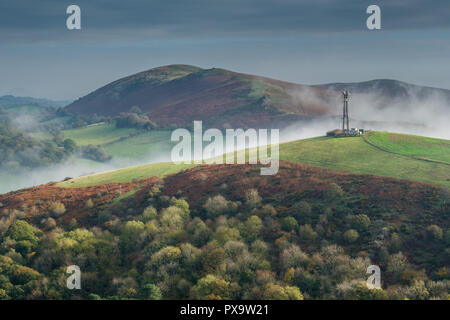 Mist snaking its way between Hazler and Hope Bowdler Hill, Church Stretton, Shropshire - Stock Image