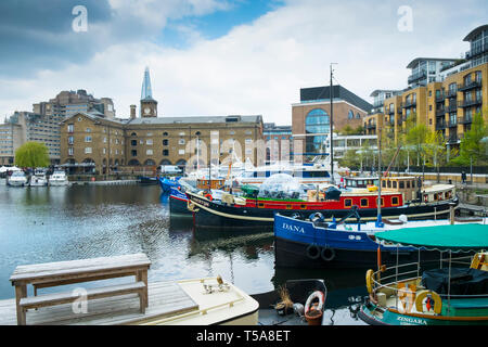 Boats and houseboats moored in St Katherine Dock St Katherines Dock in Wapping in London. - Stock Image