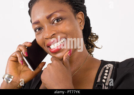 Young businesswoman in communication, hand under chin with a beautiful smile. - Stock Image