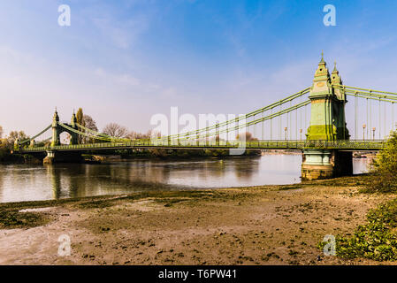 Low tide on River Thames at Hammersmith Bridge, London, UK - Stock Image