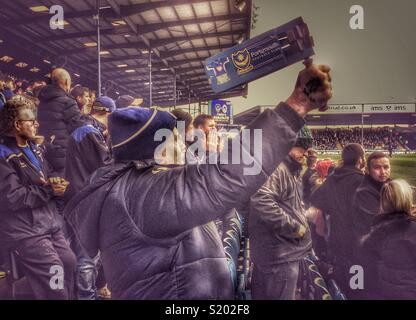 Pompey, Portsmouth supporter using a traditional football rattle during a match, Fratton Park, Portsmouth, Hampshire, England, UK - Stock Image