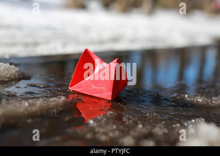 paper boat in a pool - Stock Image
