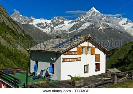 Mountain restaurant Europaweghütte at the Täschalp against the Weisshorn peak, Täsch, Taesch, Valais, Switzerland - Stock Image