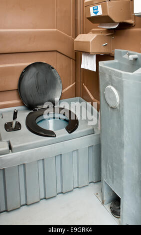The inside of a clean portaloo often hired to be used at festivals and building sites. - Stock Image