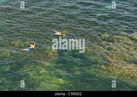 Corfu - two boys swimming in the Ionian sea near the Castle. - Stock Image