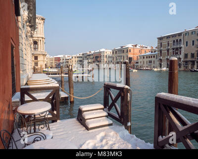 italy, in winter:  snow on a hotel landing stage along the Grand Canal in Venice - Stock Image
