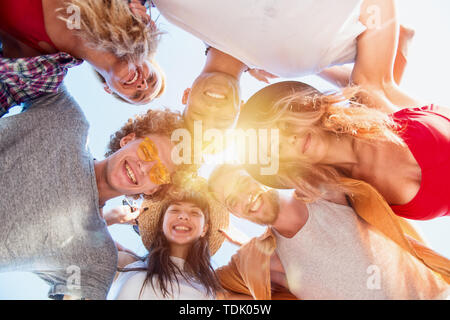 Happy smiling embracing friends at the beach - Stock Image