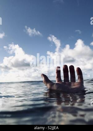 A hand floating in water. Hanalei Bay, Kauai, USA. - Stock Image