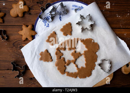 Cookie dough with cut out shapes - Stock Image