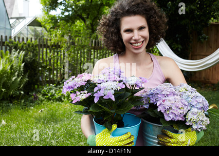 portrait of young woman with flowers - Stock Image