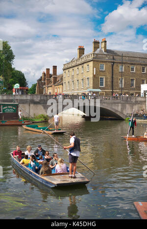 Tourists sit on a packed punt on the river cam on a bright summers day in Cambridge - Stock Image