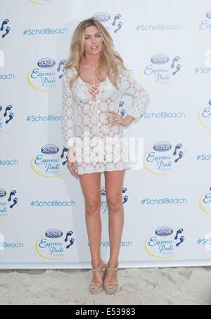 London, UK. 18th July, 2014. Abbey Clancy at the pop up beach at Westfield White city organised by Scholl Pedicare - Stock Image