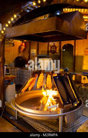 Loimulohi, blazed salmon, fire cooked salmon, Autumn market, Gerhart-Hauptmann-Platz, Hamburg, Germany - Stock Image