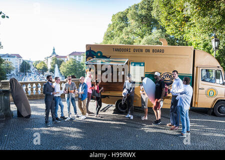 Group of customers waiting at food truck - Stock Image