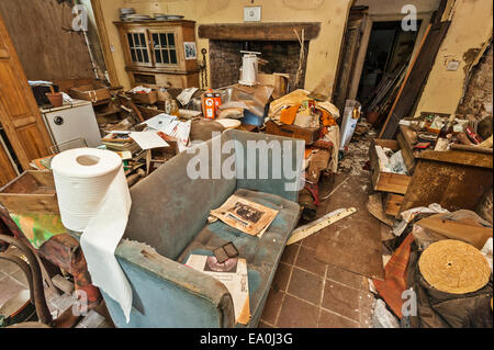 A derelict parlour in an abandoned house - Stock Image