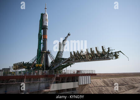 The Soyuz MS-05 spacecraft is seen after being raised into a vertical position on the launch pad at the Baikonur - Stock Image