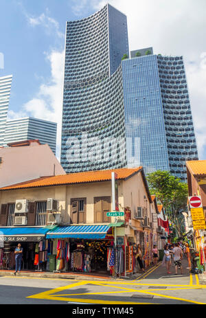 DUO and Gateway office towers over Arab Street traditional shophouses fabric shops Kampong Glam Singapore. - Stock Image