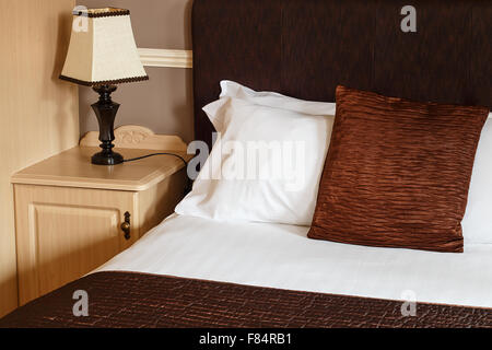 Bed and breakfast generic room with detail of bed, sheets and bedside cabinet great for any guest house. - Stock Image
