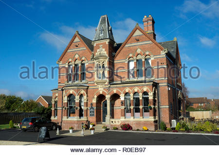 The Godwins - red brick Gothic style hotel (listed building) was built in 1879-80 for William Godwin of Godwin's Tiles. Bartestree, Herefordshire, UK. - Stock Image