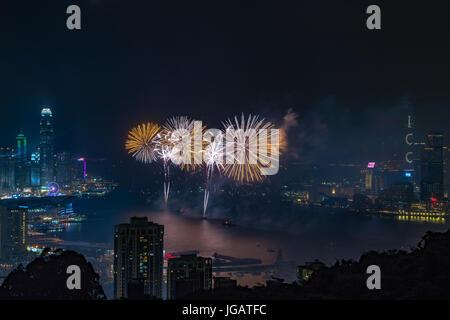 Fireworks at Victoria Harbour, Hong Kong. Commemorating 20th anniversary of Hong Kong handover to China. Credit: - Stock Image