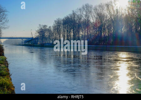 Beautiful early winter landscape with a frozen river - Stock Image