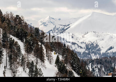 Cable cars running up the mountain in Obertauern, Austria - Stock Image