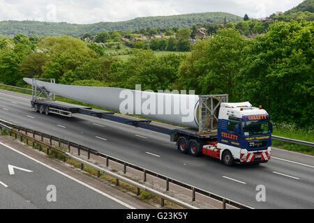 Wind turbine blade travelling on the M56 motorway in Cheshire UK - Stock Image