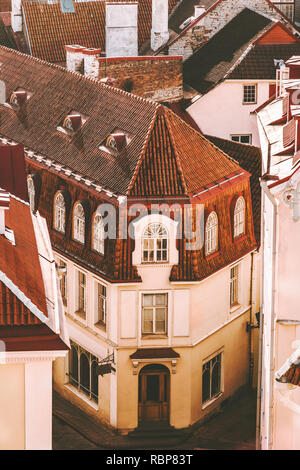 Tallinn Old Town building tiled roofs traditional architecture aerial view touristic central popular landmarks cityscape in Estonia Europe city travel - Stock Image