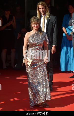 Karlovy Vary, Czech Republic. 28th June, 2019. Actress Jenovefa Bokova and her partner Martin Slozil arrive to the opening ceremony of the 54th Karlovy Vary International Film Festival begins on June 28, 2019, in Karlovy Vary, Czech Republic. Credit: Slavomir Kubes/CTK Photo/Alamy Live News - Stock Image