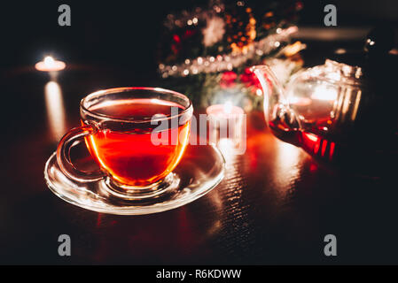 Cup of hot tea at the Christmas evening; Cozy moments at home - Stock Image