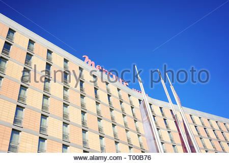 Poznan, Poland - October 31, 2018: Top of the Mercure Hotel building with flags in the foreground. - Stock Image
