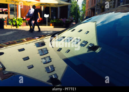 Old houses reflected in a modern car. Riga. Latvia. Summer - Stock Image