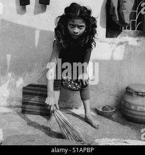 Girl with a broom, Kathmandu 2017 - Stock Image