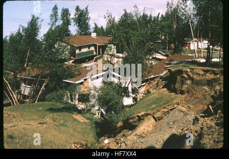 Result of earthquake of March 27, 1964. Upheaval of soil and destroyed houses; near Anchorage, Alaska. - Stock Image