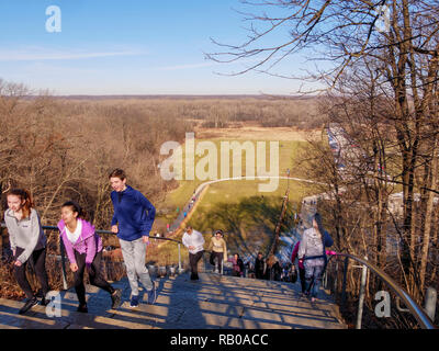 Illinois, USA. 5th January 2019. A balmy January day with temperature reacing 50ºF/10ºC brings throngs of people to stair climb at the formidable Swallow Cliff Stairs in this forest preserve southwest of Chicago.  The stairs climb a 100 foot/30 meter bluff overlooking the CalSag Valley and are a popular spot for cardio training. The stairs formerly served tobogan slides which were removed in 2004. Credit: Todd Bannor/Alamy Live News - Stock Image