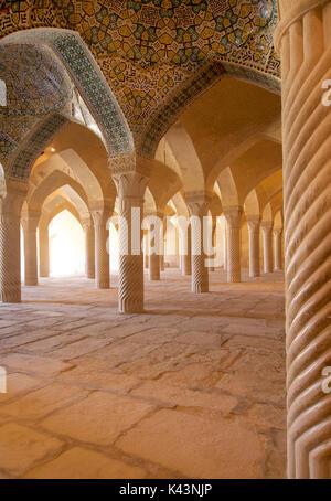 Shabestan pillars inside the prayer hall of Vakil Mosque, Shiraz, Iran - Stock Image