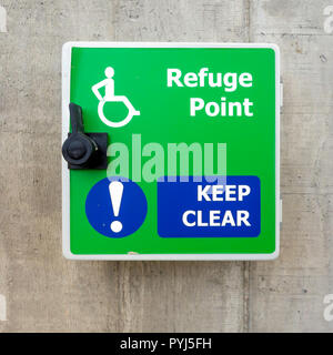 Refuge Point notice and latch providing  emergeny access for wheelchairs on an external walkway - Stock Image