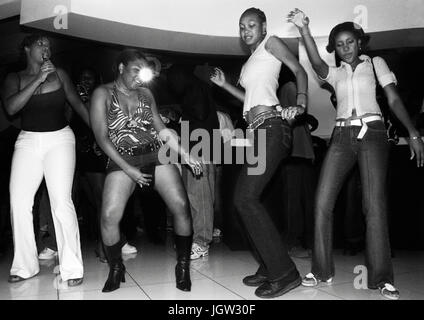Local youths dance at Kingston's hottest Dancehall nightclub Club Quad. Kingston, Jamaica, Eastern Caribbean. - Stock Image