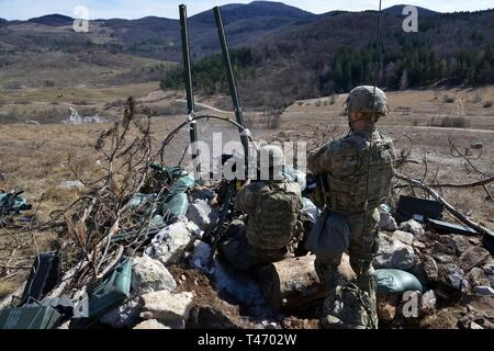 U.S. Army Paratroopers assigned to the 173rd Brigade Support Battalion, 173rd Airborne Brigade, engage the targets with MK19 grenade launcher during a live-fire exercise as part of Lipizzaner V at Pocek Range in Postonja, Slovenia, Mar. 13, 2019. Lipizzaner is a combined squad-level training exercise in preparation for platoon evaluation, and to validate battalion-level deployment procedures. The 173rd Airborne Brigade is the U.S. Army Contingency Response Force in Europe, capable of projecting ready forces anywhere in the U.S. European, Africa or Central Commands' areas of responsibility. - Stock Image