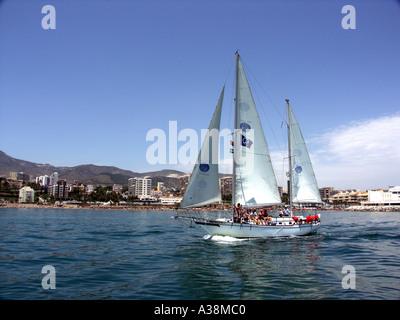 Yacht sailing in the Mediterranean Sea off the coast of Benalmadena, Costa del Sol, Spain - Stock Image