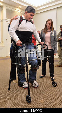 Wallingford CT USA- Michael Loura, a patient at Gaylord Hospital uses a EKSO wearable robotic exoskeleton to 'walk' - Stock Image