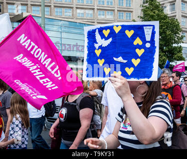 "Germany, Berlin, Mitte, 19th May 2019. ""One Europe for All' Demonstration - people gathered at Alexanderplatz as part of a Nationwide demonstration to promote solidarity in Europe in a run up to the upcoming European Elections. The Demo was organised by NGOs including Campact, Pro Asyl, Attac, Mehr Demokratie and Naturfreunde, the Seebrücke movement & Paritätischer Wohlfahrtsverband to oppose the racism, hate and resentment against minorities that is stirred up by right-wing activists and policies. Credit: Eden Breitz/Alamy - Stock Image"