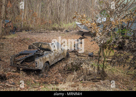 A home and vehicle in the Leilani Estates destroyed by a lava flow from the eruption of the Kilauea volcano May 19, 2018 in Pahoa, Hawaii. - Stock Image