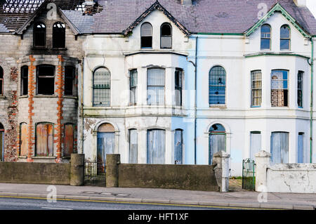 Burned out and derelict houses - Stock Image