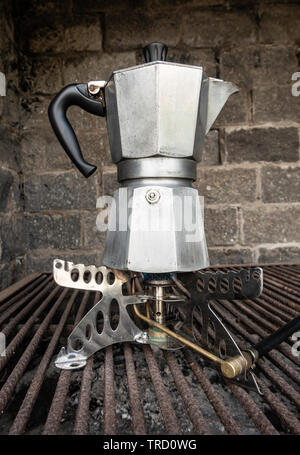 Spanish Cafetera/ Italian Moka coffee maker on camping gas stove. - Stock Image