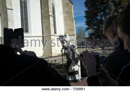 Mobile phone users photograph a participant at the Annecy Venetian Carnival. Annecy. Auvergne-Rhone-Alpes, south east France. - Stock Image