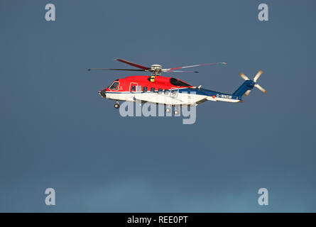 Sikorsky S-92A Helibus returning to Aberdeen Dyce Heliport after a flight to a North Sea Oil Platform to complete a crew changeover. - Stock Image