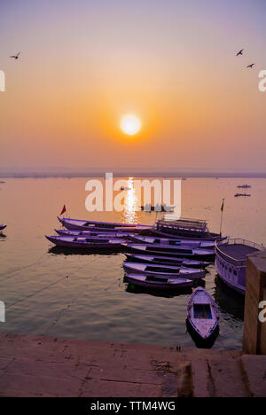 Boats on a ghat of Ganges river, Varanasi, India - Stock Image